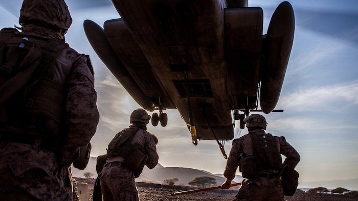 U.S. Marines prepare to attach a concrete barrier to a CH-53E Super Stallion during helicopter external load training at Arta Beach, Djibouti, Feb. 16, 2017. A helicopter support team consists of three Marines; two hook men and an overall supervisor to ensure proper procedures are followed. The 11th Marine Expeditionary Unit, part of the Makin Island Amphibious Ready Group, is operating in the U.S. 5th Fleet area of responsibility to support security and stability in the region. The Marines are with Combat Logistics Battalion 11 and the Stallion and crew are with Marine Medium Tiltrotor Squadron 163 (Reinforced), 11th MEU.