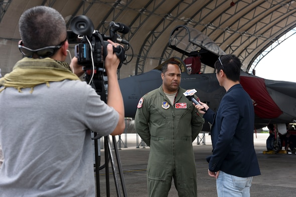 U.S. Air Force Maj. Marc Morris, 67th Fighter Squadron F-15 Eagle pilot, speaks to media Feb. 22, 2017, at Andersen Air Force Base, Guam. A flightline tour was conducted as an opportunity for reporters to observe operations of annual exercise Cope North. Squadrons from various U.S., Australian and Japanese air force units provided aircraft static displays to reporters, demonstrating their level of commitment and posture to protect and stabilize the Indo-Asia Pacific. Participants from Kadena Air Base included the 909th Air Refueling Squadron and 961st Airborne Air Control Squadron. (U.S. Air Force photo by Senior Airman John Linzmeier)