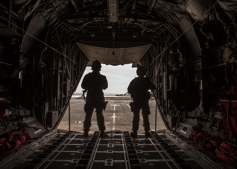 Staff Sgt. Ryan Malicki, left, and Senior Airman Ryan Donato, right, 386th Expeditionary Security Forces Squadron Fly-Away Security Team members, monitor the flightline during a FAST drill at an undisclosed location in Southwest Asia, Feb. 5, 2017. These teams are used when additional security is required at the aircraft's destination. (U.S. Air Force photo/Senior Airman Andrew Park)