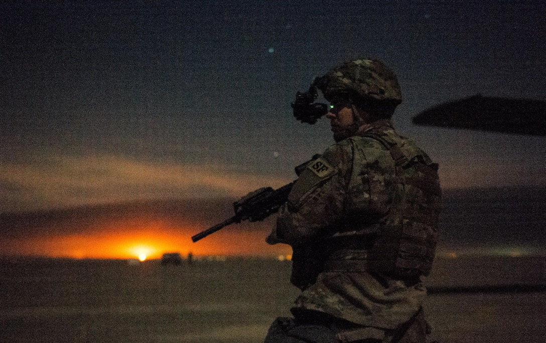 Senior Airman Henry Nokes, 386th Expeditionary Security Forces Squadron Fly-Away Security Team member, secures a section of airfield outside a C-130 Hercules at an undisclosed location in Southwest Asia, Feb. 4, 2017. Nokes was responsible for securing a flank of the aircraft while Airmen with the 737th Expeditionary Airlift Squadron delivered thousands of pounds in supplies to aid in the fight against the Islamic State of Iraq and the Levant and Mosul offensive. (U.S. Air Force photo by Senior Airman Jordan Castelan)