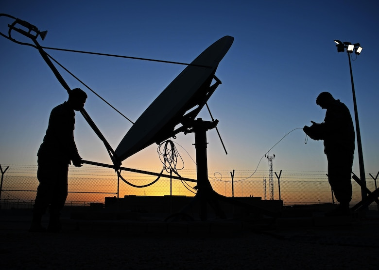 U.S. Air Force Staff Sgt. Chris Hayes, a Bounty Hunter crew chief, and U.S. Air Force Staff Sgt. Lucas Woods, a defensive space control maintainer, both with the 379th Expeditionary Operations Support Squadron, manually redirect an antenna at Al Udeid Air Base, Qatar, Jan. 30, 2017. These antennas are an Operation Silent Sentry asset and help find and locate electromagnetic interference in the U.S. Central Command area of responsibility. (U.S. Air Force photo by Senior Airman Miles Wilson)