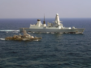 From left, Coastal patrol ship USS Monsoon (PC 4) and French Marine Nationale anti-air frigate FS Forbin (D620) participate sail side by side during exercise Khunjar Haad. Khunjar Haad is an annual, multilateral exercise conducted with the Royal Navy of Oman, Royal Navy and French Marine Nationale designed to develop the necessary skills to address threats to freedom of navigation and international commerce. USS Monsoon is deployed in the U.S. 5th Fleet area of operations in support of maritime security operations designed to reassure allies and partners, preserve the freedom of navigation and the free flow of commerce and enhance regional stability.