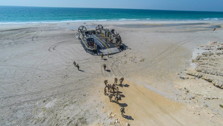 SENOOR BEACH, Oman (Feb. 15, 2017) U.S. Marines and Sailors with the Makin Island Amphibious Ready Group and 11th Marine Expeditionary Unit offload from a Landing Craft Air Cushion at Senoor Beach, Oman, before the beginning of Exercise Sea Soldier, Feb. 15. Sea Soldier 2017 is an annual, bilateral exercise conducted with the Royal Army of Oman designed to demonstrate the cooperative skill and will of U.S. and partner nations to work together in maintaining regional stability and security. USS Somerset, with the embarked 11th Marine Expeditionary Unit, is deployed in the U.S. 5th Fleet area of operations in support of maritime security operations designed to reassure allies and partners, preserve the freedom of navigation and the free flow of commerce and enhance regional stability.  (U.S. Marine Corps photo by Gunnery Sgt. Robert B. Brown Jr.)