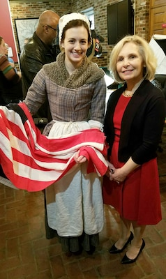 "DLA Troop Support flag room embroider, right, met a Betsy Ross interpreter during a museum exhibit opening at the Betsy Ross House Feb. 17in Philadelphia. Farrell is one of 16 DLA embroiders featured in ""Historic Threads: 250 Years of Flag Making in Philadelphia,"" which highlights the city's centuries-long tradition of flag making."