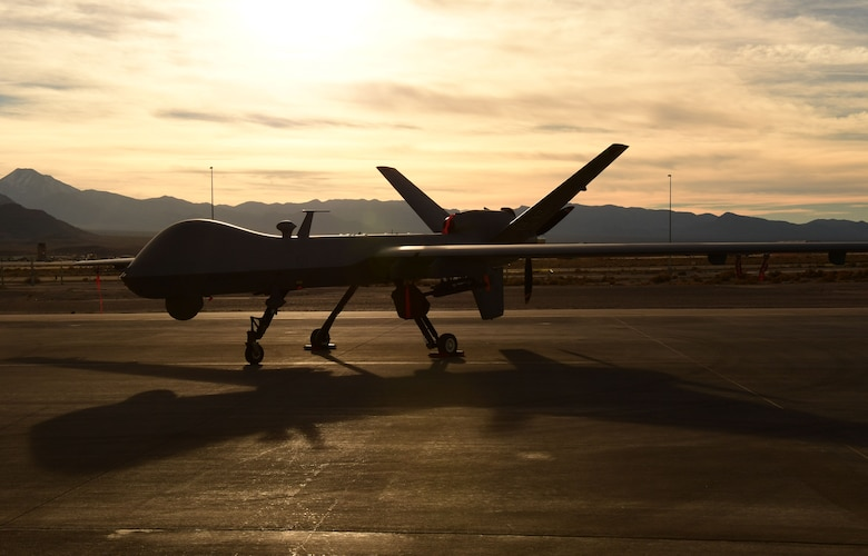 A U.S. Air Force MQ-9 Reaper awaits maintenance Dec. 8, 2016, at Creech Air Force Base, Nev. The MQ-1 Predator has provided many years of service and the time has come for the Air Force to transition to the more capable MQ-9 exclusively, and retire the MQ-1 in early 2018 to keep up with the continuously evolving battlespace environment. (U.S. Air Force photo by Senior Airman Christian Clausen)