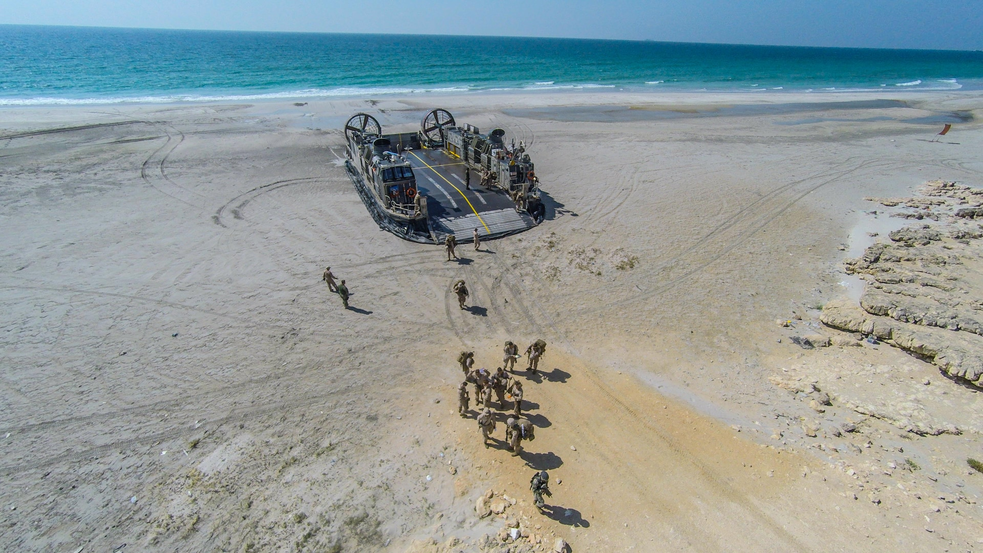 U.S. Marines and Sailors with the Makin Island Amphibious Ready Group and 11th Marine Expeditionary Unit offload from a Landing Craft Air Cushion at Senoor Beach, Oman, before the beginning of Exercise Sea Soldier, Feb. 15. Sea Soldier 2017 is an annual, bilateral exercise conducted with the Royal Army of Oman designed to demonstrate the cooperative skill and will of U.S. and partner nations to work together in maintaining regional stability and security. USS Somerset, with the embarked 11th Marine Expeditionary Unit, is deployed in the U.S. 5th Fleet area of operations in support of maritime security operations designed to reassure allies and partners, preserve the freedom of navigation and the free flow of commerce and enhance regional stability.