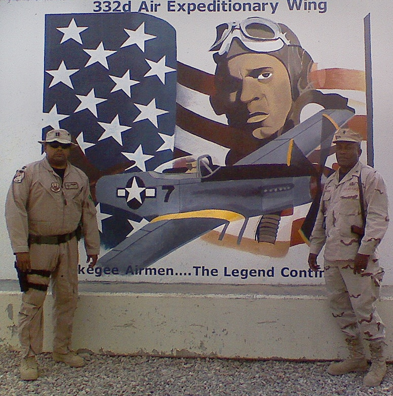 Then Capt. Ronnie, now Lt. Col., with the 432nd Wing/432nd Air Expeditionary Wing, left, and his father, then Brig. Gen. Ronnie, now retired Lt. Gen., right, stand in front of the 332nd Air Expeditionary Wing Tuskegee Airmen mural September 2007, at Joint Base Balad, Iraq. (Courtesy photo)