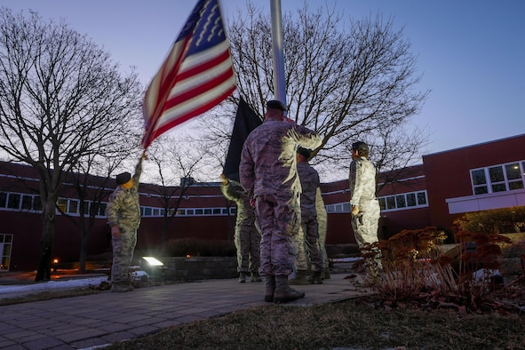 Defenders of the 934th Security Forces Squadron honor Old Glory during Reveille on Feb 12, 2017 signaling the official start of the duty day. (U.S. Air Force photo by Staff Sgt. Corban Lundborg)