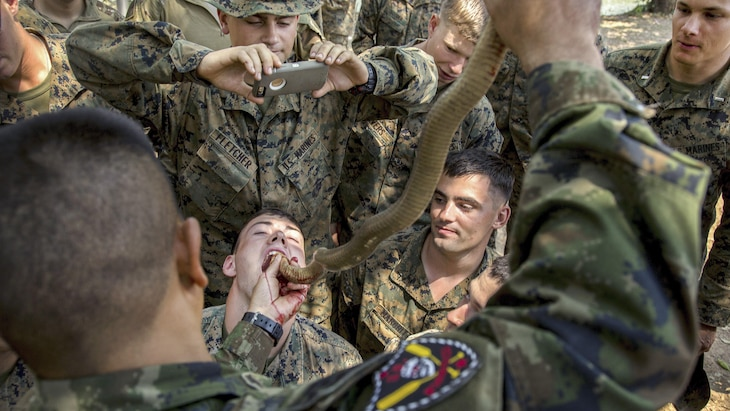 Marines drink cobra blood during survival training as part of Cobra Gold 17, a humanitarian relief exercise, at Camp Ban Chan Krem, Thailand, Feb. 17, 2017. Marine Corps photo by Cpl. Steven Tran
