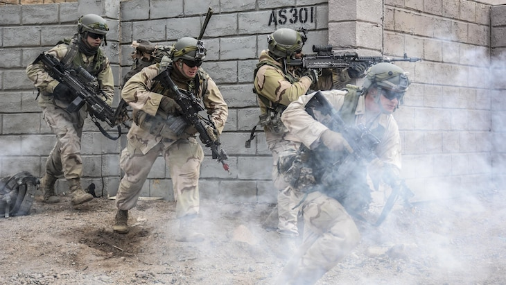 Soldiers maneuver through the town of Barasu in the National Training Center at Fort Irwin, Calif., Feb. 20, 2017, while attempting to recapture the city. Army photo by Pvt. Austin Anyzeski