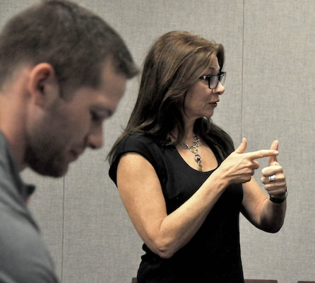 Visual information specialist Angela Shannon instructs class in American Sign Language.