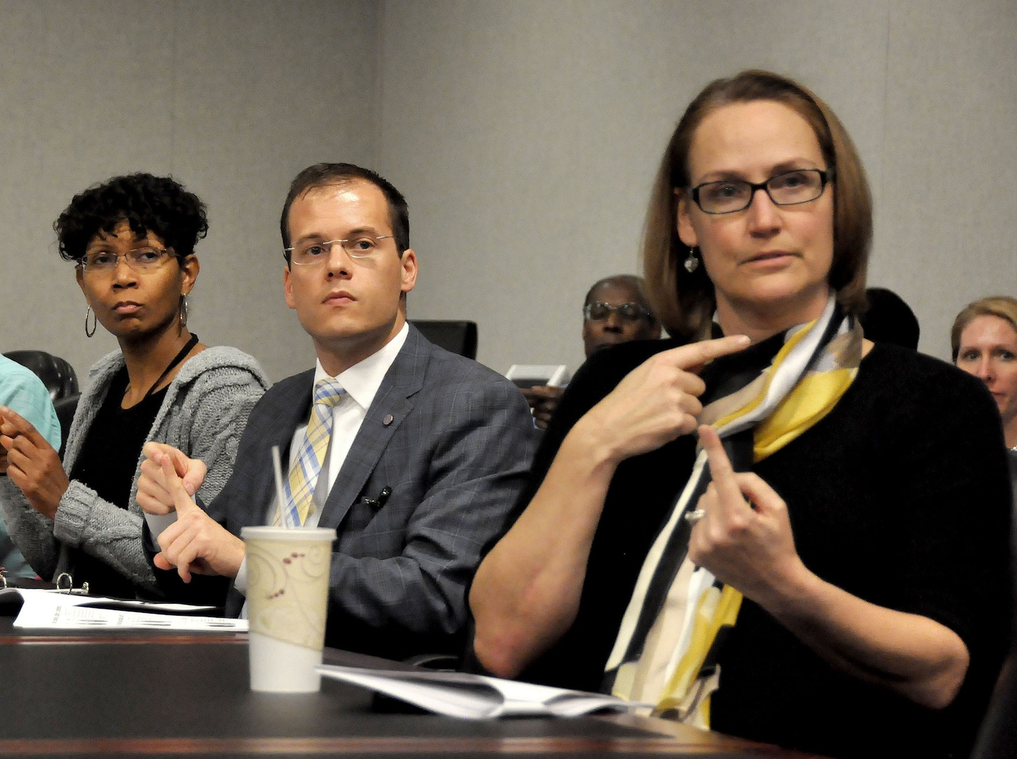 From left, Towana Barnett, Defense Technical Information Center, Christopher Kehoe, DLA Equal Employment Opportunity Office and Janice Sypolt, DLA Logistics Operations, participate in the DLA lunchtime American Sign Language class.