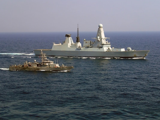 From left, Coastal patrol ship USS Monsoon (PC 4) and French Marine Nationale anti-air frigate FS Forbin (D620) participate sail side by side during exercise Khunjar Haad. Khunjar Haad is an annual, multilateral exercise conducted with the Royal Navy of Oman, Royal Navy and French Marine Nationale designed to develop the necessary skills to address threats to freedom of navigation and international commerce. USS Monsoon is deployed in the U.S. 5th Fleet area of operations in support of maritime security operations designed to reassure allies and partners, preserve the freedom of navigation and the free flow of commerce and enhance regional stability. (Photo by (Courtesy photo of Royal Navy))
