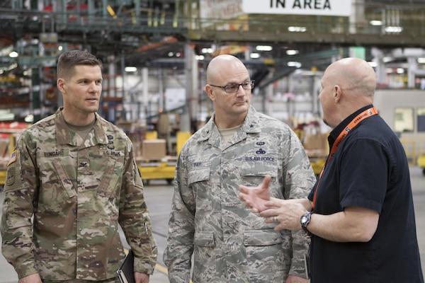 Air Force Brig. Gen. Allan E. Day (center), commander of DLA Aviation visited DLA Distribution Feb. 22 for an overview of DLA Distribution, and a tour of Distributions largest warehouse, the Eastern Distribution Center at DLA Distribution Susquehanna, Pennsylvania.
