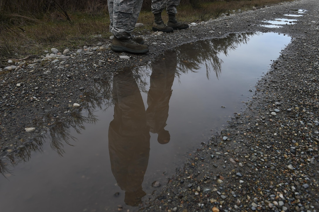 Members of the 627th Civil Engineer Squadron stop to discuss their route back during land navigation training to on Joint Base Lewis-McChord, Wash., Feb. 16, 2017. The group of 50 spent three hours in a classroom learning the basics of land navigation including map orientation and grade ordinates prior to putting their training to use. (U.S. Air Force photo/Staff Sgt. Naomi Shipley)