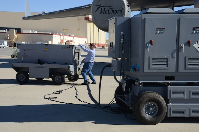 Ryan Tipton, 412th Maintenance Squadron, fires up a legacy diesel generator to recharge the Hybrid Electric Flightline Cart Technology Pathfinder on the flightline here. The HEF maintained enough power to complete the required C-17 checks before it was due a recharge. (U.S. Air Force photo by Christopher Ball)