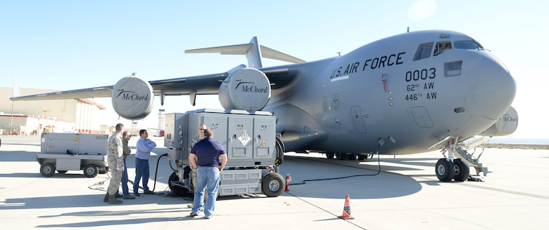 The test team monitors the HEF during the C-17 portion of the Hybrid Electric Flightline Cart Technology Pathfinder tests. The HEF was a concept demonstrator built to explore an all-electric or hybrid electrical power supply for use by flightline maintainers. Some possible advantages are lower noise, less emissions and less maintenance than the diesel generators currently in use. (U.S. Air Force photo by Christopher Ball)