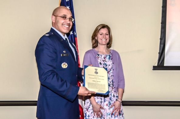 Hillary Merritt, project manager for The Trust for Public Land, was presented an Air Force level award Feb. 22, 2017 by Col. David Miller, Jr., 460th Space Wing commander, at the Aurora Municipal Center in Aurora, Colo. The Commander's Public Service Award is designed to recognize service or achievements of a private citizen who has contributed significantly to the accomplishment of the mission of an Air Force Agency. (U.S. Air Force photo by Airman 1st Class Jessica A. Huggins/Released)