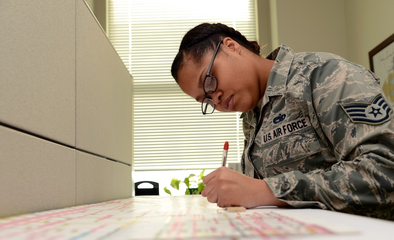 Staff Sgt. Kursten Harris, 62nd Maintenance Group plans, scheduling and documentation office NCO in charge, reviews schedules Feb. 22, 2017 at Joint Base Lewis-McChord, Wash. The 62nd MXG plans, scheduling and documentation office schedules hundreds of maintenance actions yearly for aircraft and track past, current and future maintenance actions. (U.S. Air Force photo/Senior Airman Jacob Jimenez)