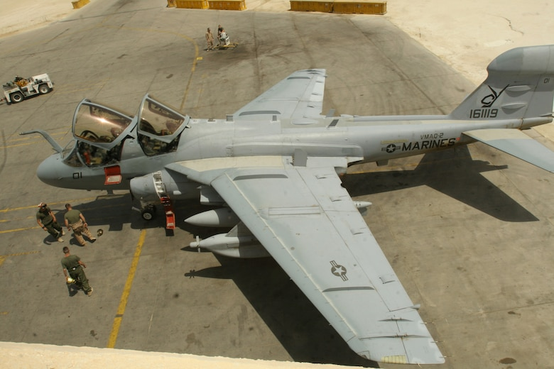 "Maintenance Marines with Marine Tactical Electronic Warfare Squadron 2, Marine Aircraft Group 16 (Reinforced), 3rd Marine Aircraft Wing (Forward), begin a post-flight inspection of an EA-6B Prowler at Al Asad, Iraq, June 18, 2006. The ""Death Jester's"" wrench turners were a critical force behind the squadron reaching a 3,000 flight hours milestone July 13.(Marine Corps photo by Cpl. Jonathan Televich/ Released)"