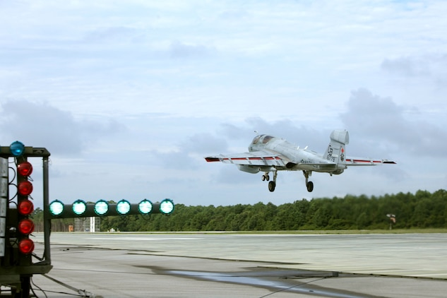 An EA-6B Prowler takes off from a 'touch and go' landing during Marine Tactical Electronic Warfare Training Squadron 1's last flight operations for the Prowler at Marine Corps Auxiliary Landing Field Bogue, Aug. 20, 2015. Four student pilots are among the last to learn how to fly the Prowler due to its transitioning out of the Marine Corps starting in 2016. (Marine Corps photo by Cpl. Jason Jimenez/ Released)