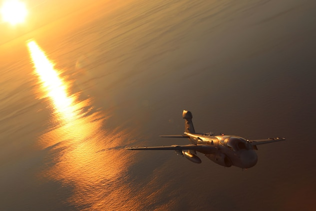 An EA-6B Prowler, belonging to 2nd Marine Aircraft Wing glides through cascading sunlight while conducting aerial maneuvers during an air-to-air refuel training exercise over the Atlantic Ocean Sept. 14, 2015. Aircraft from Marine Corps Air Station Cherry Point, N.C., were supported by Marine Aerial Refueler Transport Squadron 252 off the eastern Atlantic coast during the training exercise to hone their aerial refueling skills. VMGR-252 is the force multiplier for the Marine Air-Ground Task Force as it extends the operational reach of other aviation platforms under all weather conditions, day or night during expeditionary, joint or combined operations. (U.S. Marine Corps photo by Cpl. N.W. Huertas/Released)