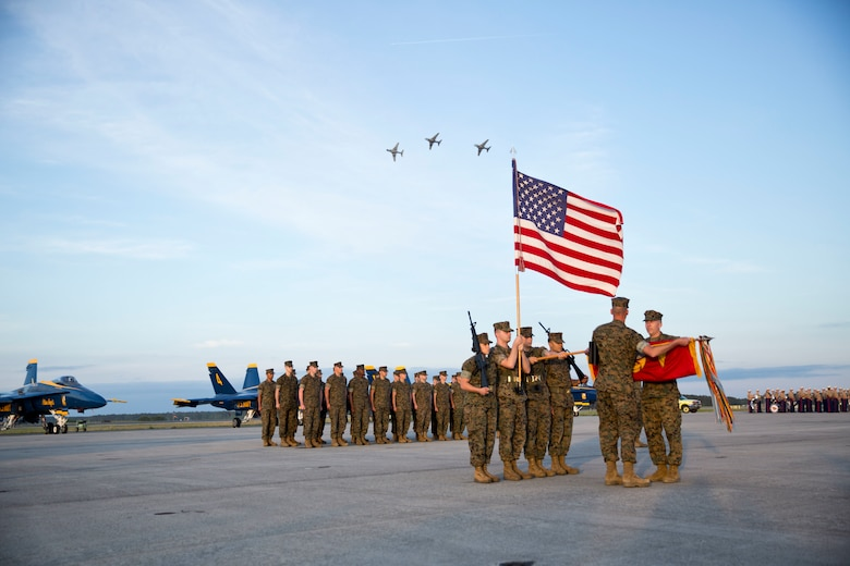 U.S. Marines assigned to Marine Tactical Electronic Warfare Training Squadron 1 attendees stand in formation during a deactivation ceremony at Marine Corps Air Station Cherry Point, N.C., April 29, 2016. VMAQT-1 is the first of four Prowler squadrons to be deactivated after more than 60 years of service. Marine Air-Ground Task Force - Electronic Warfare is what the Marine Corps will transition to as the Prowler is replaced. (U.S. Marine Corps photo by Cpl. Jodson B. Graves/Released)