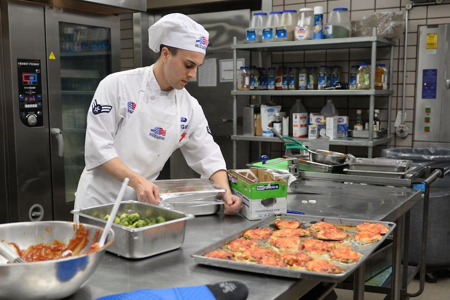 U.S. Air Force Airman 1st Class Tyler Morgan, a 354th Force Support Squadron food service journeyman, wraps vegetables for lunch Feb. 22, 2017, at Eielson Air Force Base, Alaska. The Two Seasons Dining Facility was the Pacific Air Forces nomination to compete for the Air Force Hennessy Award. (U.S. Air Force photo by Airman 1st Class Cassandra Whitman)
