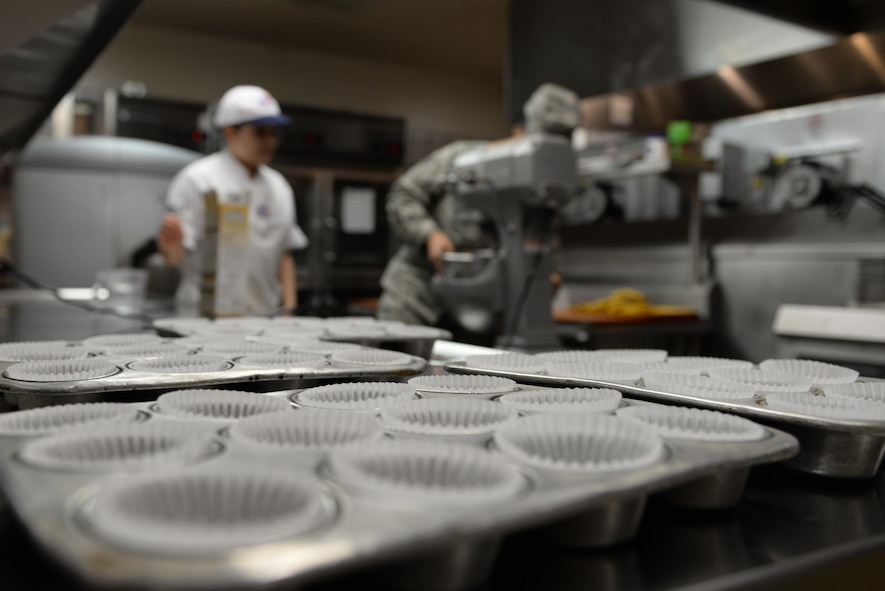 U.S. Air Force Airman 1st Class Guadalupe Estrada, a 354th Force Support Squadron (FSS) food service apprentice, and Staff Sgt. Erica Miller, a 354th FSS food service accountant, prepare cake batter Feb. 22, 2017, at Eielson Air Force Base, Alaska. The Two Seasons Dining Facility prepares cake and cupcakes for their quarterly birthday meal, recognizing the Airmen who have birthdays during the corresponding quarter. (U.S. Air Force photo by Airman 1st Class Cassandra Whitman)