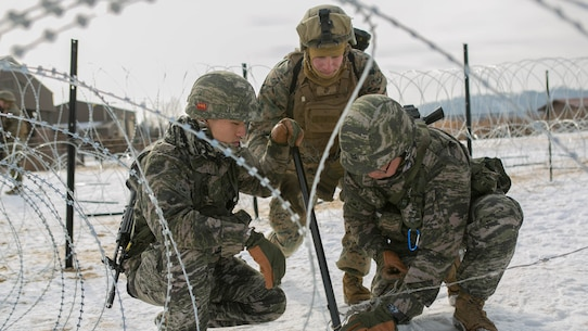U.S. Marines, with Alpha Company, 9th Engineer Support Battalion, 3rd Marine Logistics Group, and Republic of Korea Marines, with 1st Engineer Division, work together to put barbed wire around poles to create wire obstacles during the exercise Korean Marine Exchange Program (KMEP) 17-8 on New Mexico Range, South Korea, January 28, 2017. KMEP is an annually scheduled training event designed to enhance to improve the tactical interoperability and camaraderie of the Republic of Korea and U.S. Marines by allowing them to work side-by-side as a cohesive unit. The alliance between America and the Republic of Korea has grown even stronger based upon the shared interests and values of both nations. (U.S. Marine Corps photo by MCIPAC Combat Camera Lance Cpl. Tiana Boyd)