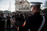 Sgt. Dalton M. Guin, assistant enlisted conductor for Marine Corps Band New Orleans, Marine Forces Reserve, leads the band in a rehearsal before marching in the Krewe of Druids parade during Mardi Gras in New Orleans, Feb. 22, 2017. The band participated in numerous parades to promote the Marine Corps and support the New Orleans community.