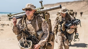 SENOOR BEACH, Oman (Feb. 15, 2017) U.S. Marine Cpl. Johnathan Riethmann, a mortarman with Company A, Battalion Landing Team 1st Bn., 4th Marines, 11th Marine Expeditionary Unit, walks to a staging area at Senoor Beach, Oman, in preparation for Exercise Sea Soldier, Feb. 15. Sea Soldier 2017 is an annual, bilateral exercise conducted with the Royal Army of Oman designed to demonstrate the cooperative skill and will of U.S. and partner nations to work together in maintaining regional stability and security. USS Somerset, with the embarked 11th Marine Expeditionary Unit, is deployed in the U.S. 5th Fleet area of operations in support of maritime security operations designed to reassure allies and partners, preserve the freedom of navigation and the free flow of commerce and enhance regional stability. (U.S. Marine Corps photo by Gunnery Sgt. Robert B. Brown Jr.)