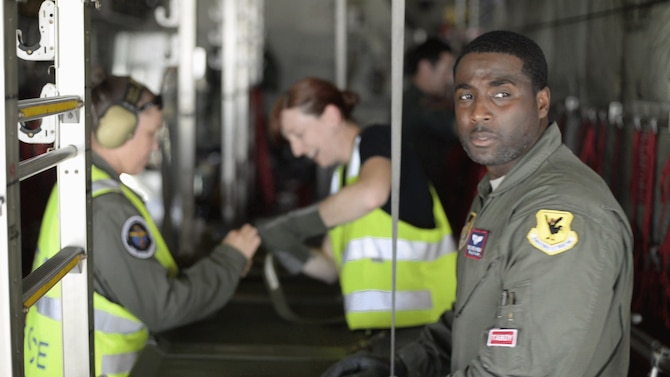 U.S. Air Force Tech. Sgt. Detrick Hysaw, 18th Aeromedical Evacuation Squadron AE technician, configures a Japan Air Self-Defense Force C-130 Hercules with Royal Australian Air Force Airmen for patient transport Feb. 21, 2017, at Andersen Air Force Base, Guam. Aeromedical evacuation Airmen from Kadena Air Base, Japan, completed medical training with Australian and Japanese airmen during annual exercise Cope North. The 18th AES maintains a forward presence and supports medical contingencies in the Pacific, reaching from the Horn of Africa to Alaska. (Courtesy photo)