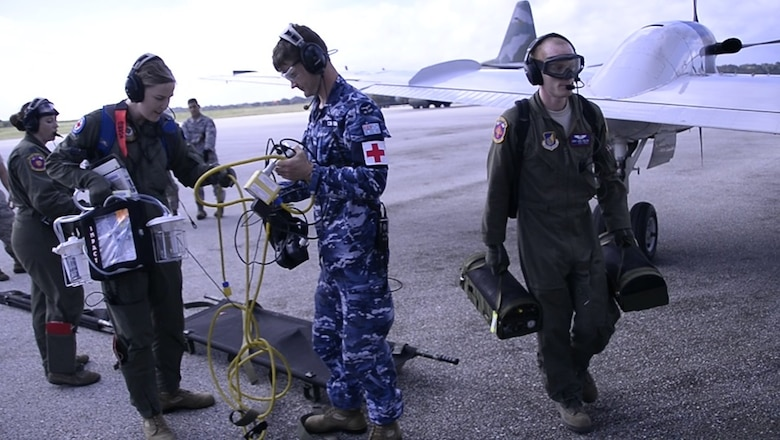 Aeromedical Evacuation Airmen from the U.S., Japanese and Australian air forces transport a simulated patient to a U.S. Air Force C-12 Huron as part of annual exercise Cope North Feb. 21, 2017, at Tinian Air Field. Aeromedical evacuation training was conducted on the Huron to familiarize airmen with patient care on a new airframe. Cope North is a long-standing exercise designed to enhance multilateral air operations between the partnered militaries, bringing together more than 2,700 U.S. Airmen, Sailors and Marines who are training alongside approximately 600 combined JASDF and RAAF participants.  (Courtesy photo)