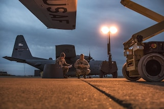 Air Force Senior Airman Hunter Mitchell, left, and Master Sgt. Christopher Antram discuss the day's maintenance workflow as the sun rises over Mansfield Lahm Air National Guard Base, Mansfield, Ohio, Feb. 21, 2017. Mitchell and Antram are aerospace propulsion specialists assigned to the Ohio Air National Guard's 179th Airlift Wing. Air National Guard photo by 1st Lt. Paul Stennett