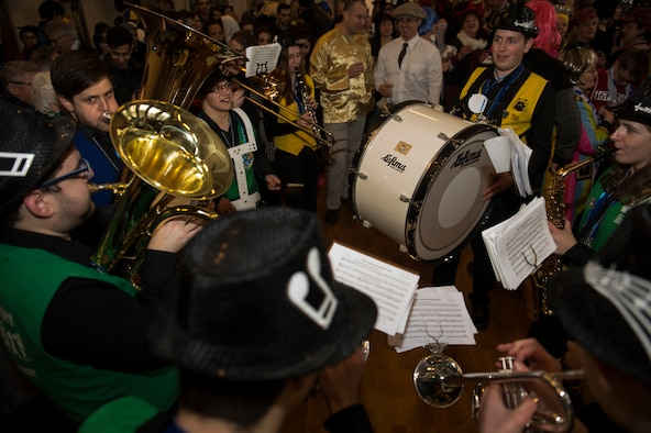 Musicians play music while revelers lock arms and dance to music as part of a Fasching celebration at the city hall in Bitburg, Germany, Feb. 22, 2017. Fasching is a yearly celebration put on by the Germans to commemorate the start of the spring season. (U.S. Air Force photo by Senior Airman Dawn M. Weber)