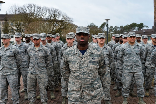 786th Civil Engineer Squadron Airmen stand at parade rest during a memorial service for the River Rats Memorial monument on Ramstein Air Base, Germany, Feb. 17, 2017. The Red River Rats Fighter Pilots Association, which was formed during the Vietnam War, established the monument at Ramstein in 1976 to commemorate Airmen who never returned from Vietnam. The 786th CES recently repaired the monument, which had fallen into disrepair over the years. (U.S. Air Force photo by Airman 1st Class Joshua Magbanua)