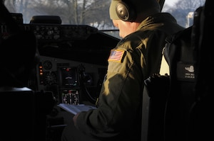 Lt. Col. Charles Taylor, a pilot assigned to the 185th Air Refueling Wing, examines preflight checklists on a KC-135 aircraft at Geilenkirchen NATO Air Base on Feb. 14 2017. Approximately 40 members of the 185th are working at the air base supporting NATO training operations.