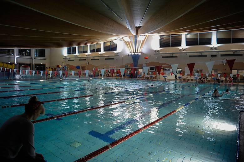Participants enter the pool for a swim class at the Aquatic Center on Ramstein Air Base, Germany, Feb. 14, 2017. Each week, Christina and Samantha Moore, take aquatic classes, yoga, and shoot for more than 120 minutes of exercise as part of the seventh annual Kaiserslautern Military Community's 'Biggest Loser' challenge. (U.S. Air Force photo by Airman 1st Class Savannah L. Waters)
