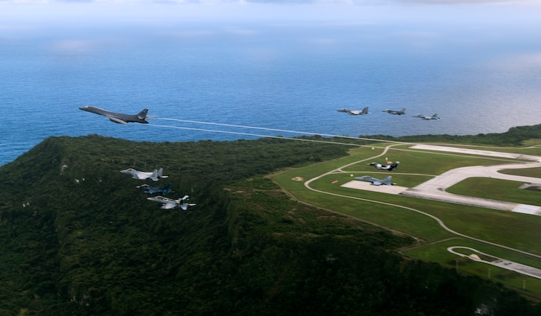 Aircraft from the United States, Japanese and Australian air forces fly in formation during exercise Cope North 2017 off the coast of Guam, Feb. 21, 2017. The exercise includes 22 total flying units and more than 2,700 personnel from three countries and continues the growth of strong, interoperable relationships within the Indo-Asia Pacific Region through integration of airborne and land-based command and control assets. (U.S. Air Force photo/Staff Sgt. Aaron Richardson)