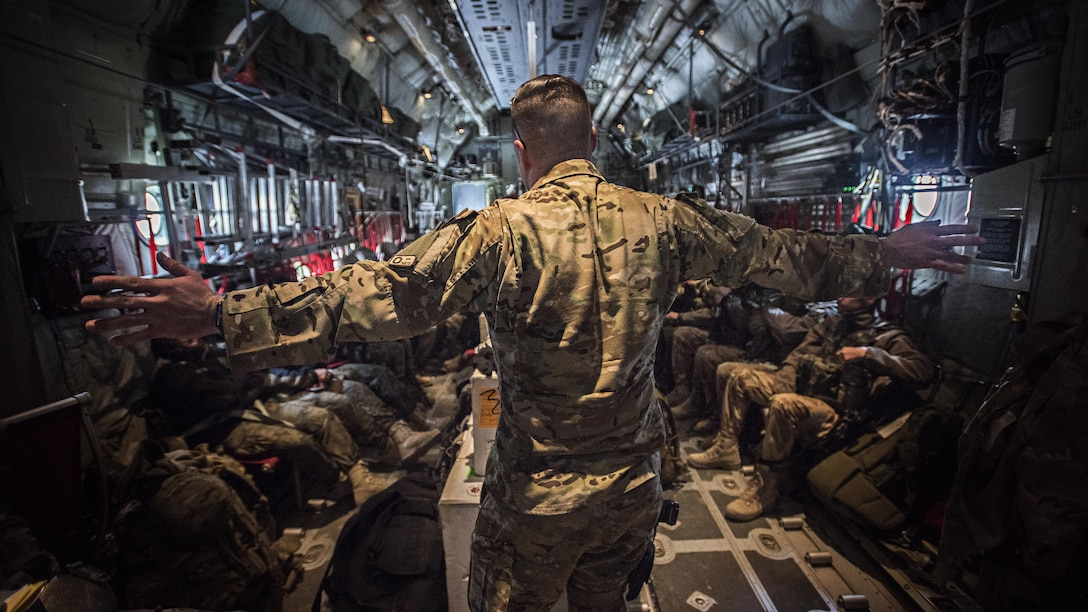Staff Sgt. Chase Seynaeve, a 774th Expeditionary Airlift Squadron loadmaster, gives a flight safety briefing to passengers on a C-130J Super Hercules leaving from Bagram Airfield, Afghanistan, Feb. 17, 2017. The 774th EAS provides tactical airlift, including aeromedical evacuation, cargo and personnel airlift and airdrop, and any intra-theater transportation needed to support a successful train, advise, assist mission in Afghanistan. (U.S. Air Force photo/Staff Sgt. Katherine Spessa)