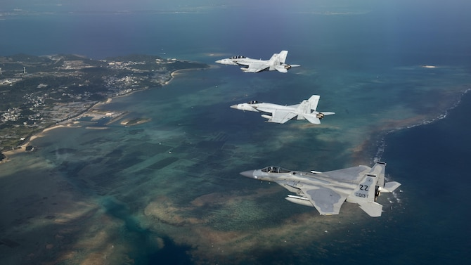 An Air Force F-15 Eagle and Navy F/A-18 Super Hornets fly in formation after a training sortie Feb. 16, 2017, over the Pacific Ocean. The joint training bolstered communications and interoperability between the two services, which both serve to enhance peace and security throughout the Indo-Asia Pacific region. (U.S. Air Force photo/Staff Sgt. Peter Reft)