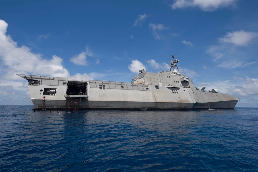 Sailors assigned to the littoral combat ship USS Coronado swim in the South China Sea, Feb. 23, 2017. Coronado is a fast and agile warship tailor-made to patrol the region's littorals and work with partner navies, providing the U.S. 7th Fleet with the flexible capabilities it needs now and into the future. Navy photo by Petty Officer 2nd Class Amy M. Ressler