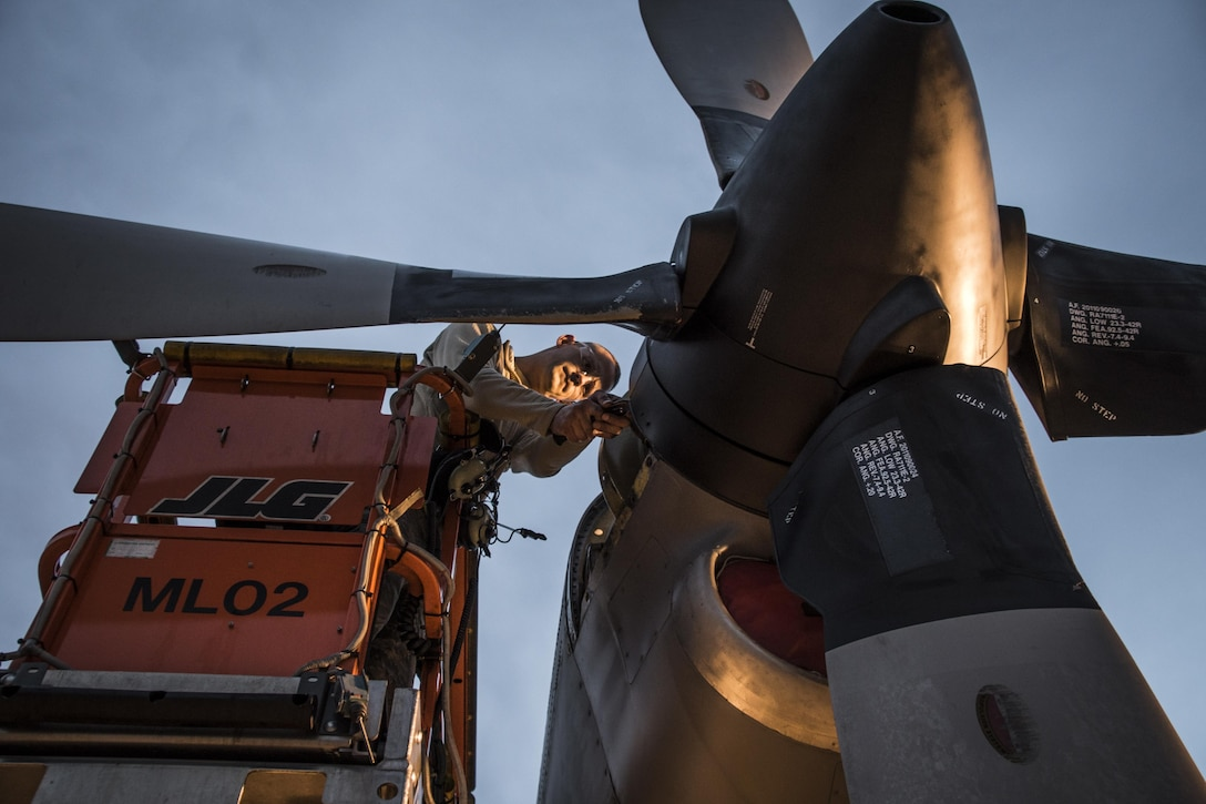 Members of the 179th Airlift Wing work on an engine of a C-130H Hercules Feb. 21, 2017, in Mansfield, Ohio. The 179th AW is always on mission to be the first choice to respond to community, state and federal missions with a trusted team of highly qualified Airmen. (U.S. Air National Guard photo/1st Lt. Paul Stennett)