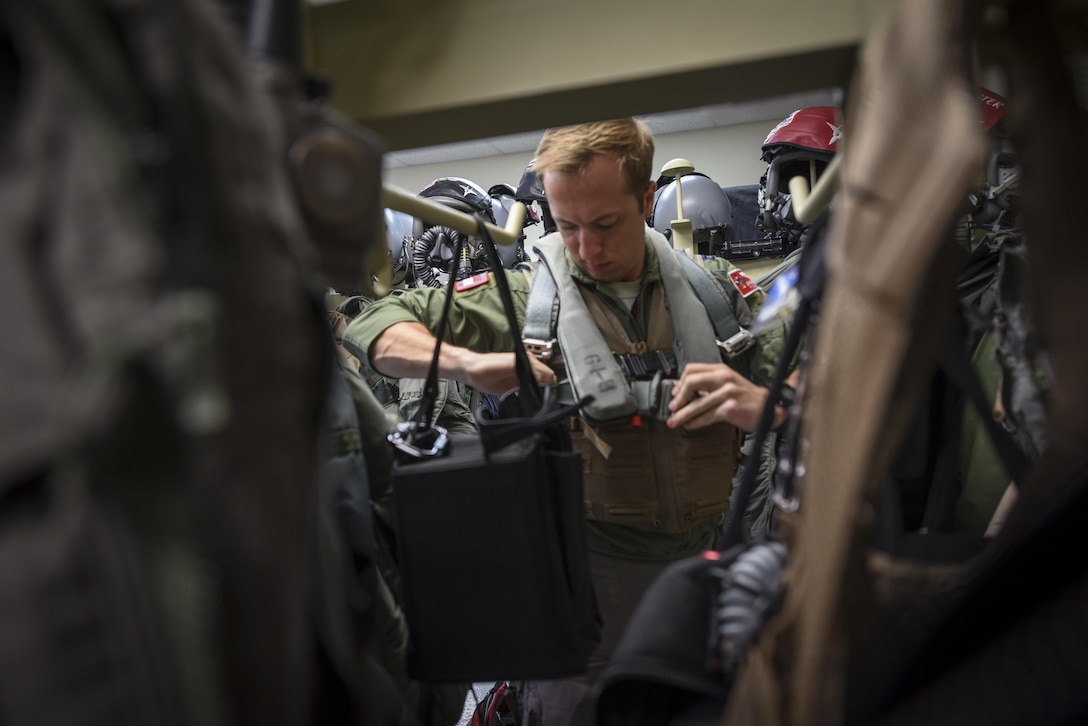 Capt. Chris Dubois, a 67th Fighter Squadron F-15 Eagle pilot, prepares for flight during exercise Cope North Feb. 20, 2017, at Andersen Air Force Base, Guam. The equipment is maintained and inspected by Airmen from the 18th Operations Support Squadron, who ensure life-saving gear will work properly in the event of an emergency. (U.S. Air Force photo/Senior Airman John Linzmeier)