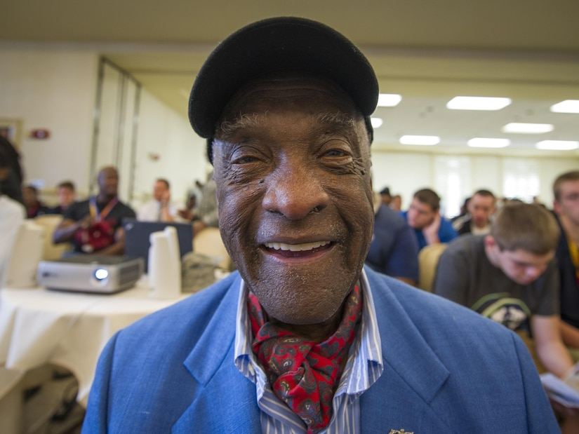 """(Ret.) Lt. Col. Enoch """"Woody"""" Woodhouse, an original Tuskegee Airman, awaits the guest speaker Feb. 23, 2017, the morning of the Tuskegee Airmen Career Day at Joint Base Charleston, S.C. More than 150 students from middle and high school boys from 17 Lowcountry school visited Joint Base Charleston Feb. 23, 2017, to learn about jobs in aviation as part of the second annual Tuskegee Airmen Career Day, hosted by the 315th Airlift Wing. The boys were able to learn about military and civilian careers in aviation by more than 15 different career fields. (U.S. Air Force photo by Senior Airman Tom Brading)"""
