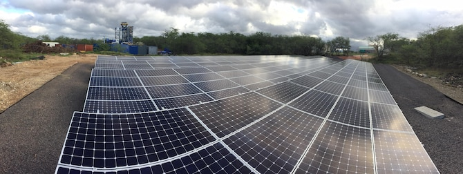 A newly-installed 134 kW photovoltaic array at Joint Base Pearl Harbor-Hickam, Hawaii, is part of the Pacific Energy Assurance and Resiliency Laboratory, a renewable energy microgrid project demonstrating new ways for military facilities to address energy needs. (Photo courtesy of HNU Energy/Joseph Cannon)