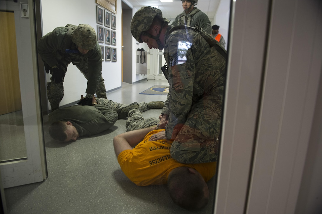 U.S. Air Force Tech. Sgt. Jason Plasner, 52nd Fighter Wing executive assistant to the command chief, acts as an active shooter during an exercise at Spangdahlem Air Base, Germany, Feb. 22, 2017. The realistic scenario involved a disgruntled Airman simulating an active shooter attack on the base. (U.S. Air Force photo by Senior Airman Dawn M. Weber)