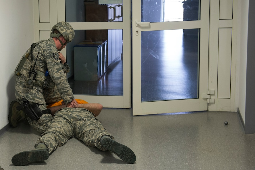 A 52nd Security Forces Squadron Airman apprehends U.S. Air Force Tech. Sgt. Jason Plasner, 52nd Fighter Wing executive assistant to the command chief, during an active shooter exercise at Spangdahlem Air Base, Germany, Feb. 22, 2017. Active shooter exercises give Security Forces Airmen a chance to test their capabilities in a realistic situation and environment. (U.S. Air Force photo by Senior Airman Dawn M. Weber)