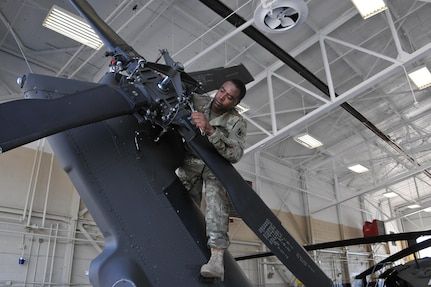 Aircrew members from the Army Reserve Aviation Command conduct pre-flight and maintenance checks on a UH-60 Blackhawk helicopter, Aug. 30. (Photos by Fort Knox Visual Information)